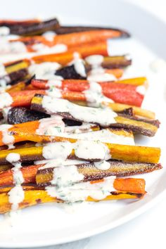 A quick and simple recipe for roasted carrots with honey, spice and the most delicious tahini sauce drizzled on top. Recipe on inspiredtaste.net | @inspiredtaste