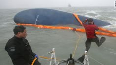 Rescue personnel dive during search operations for passengers aboard the Sewol, a South Korean ferry, in the waters of the Yellow Sea near J...