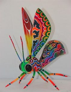 Artesanias Mexicanas hechas a mano - this is an alibrije carved from wood and painted