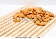 Raw whole almonds ready to snack - stock photo