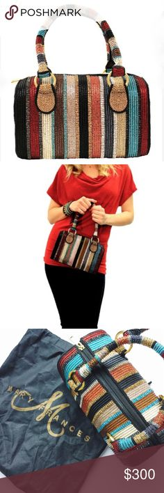 """BLACK FRI SALE🍂MARY FRANCES NEW LINE UP HANDBAG🍂 Line up from the instant wow factor! This colorful striped doctor style bag is completely covered in sparkling rhinestones that will not only add to your fashion statement, but carry all your day to night needs!  Closure: Zipper Strap: Top Handle Strap Length End To End: 17 Strap Drop Length: 6.5 Dimensions: 9.5x5x6.5 Color: Multicolored  Features: 100% hand-beaded serape striped pattern   To purchase item, please use the """"Buy Now"""" or """"Add…"""
