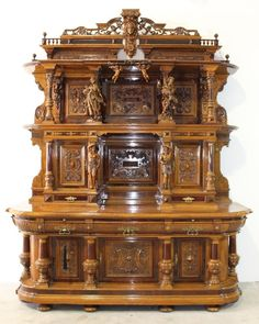 Monumental German castle court cabinet. Incredible woodworking design and beauty went into this late 19th century masterpiece. Composed of exotic rosewoods, burled walnut, mahogany and birds-eye-maple. This cabinet features turned column and carved figural posts, raised carved panel doors, heavy bronze hardware, locking compartments, hidden secret compartments, 2 slide out marble surfaces, all in extraordinary condition.