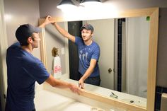 Step by step-how to frame the bathroom mirror from Young House Love