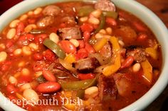 A quick skillet meal of sausage with peppers and onions, tomatoes, barbecue sauce, and beans.