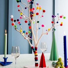 A modern alternative to the traditional Christmas tree our Pom Pom Christmas Tree is available with a choice of Neutral or Bright poms poms.The tree is available in three colourways Bright has a mixture of pink yellow blue green red White Christmas Tree Decorations, Christmas Tree Branches, Colorful Christmas Tree, Diwali Decorations, Diy Christmas Tree, Modern Christmas, Garland Decoration, Christmas Lights, Home Decoration