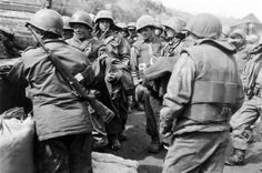 Korean War Military Units - Colombian Soldiers receive rations and equipment after engaging in a bitter fight on Korea's Old Baldy.