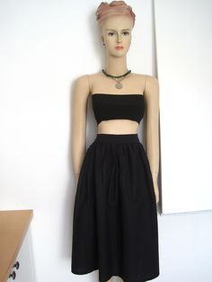 The FREE sewing pattern for this bandeau top and the skirt are on Greenie Dresses for Less. #diybandeautop #diymidiskirt #diyfashion