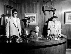 <b>Not originally published in LIFE.</b> Mickey Cohen's enforcer, Johnny Stomp Stompanato (famously stabbed and killed by Lana Turner's 14-year-old daughter, Cheryl Crane, in 1958), business manager Mike Howard and Cohen pose in Cohen's office in Los Angeles, 1949.