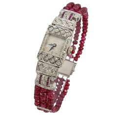 Hamilton Lady's Platinum, Diamond and Ruby Bracelet Watch on Ruby Beads. Finely made Deco watch featuring a geometric filigree design with diamonds and channel set rubies. A contemporary ruby bead band with diamond spacers and a new clasp has been added to make this a extraordinary piece. Circa 1930s