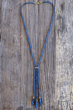 A personal favorite from my Etsy shop https://www.etsy.com/listing/456240136/long-iolite-blue-multistrand-necklace