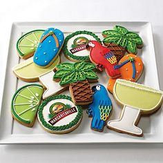 Margaritaville Frosted Cookies. Assorted sugar cookies. Limes, flip flops, parrots, Margaritaville logo, margarita glasses, palm trees. Individually wrapped in cello bags with ribbon.
