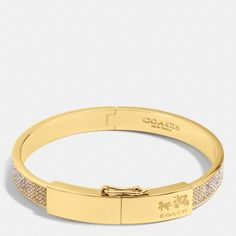 The Coach Pave Plaque Hinged Bangle from Coach $158