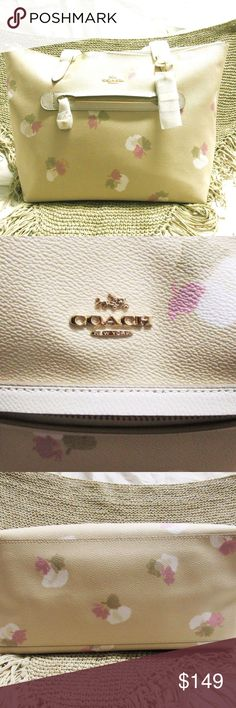 COACH TAYLOR TAN LEATHER TOTE New with tags Coach Taylor tan pastel print leather tote. Interior zipper pocket and open slot for ell phone and wallet. Comes with a protective duct bag.  Come visit us at 14902 Preston Rd Suite 720, Dallas, Tx in the Steinmart parking lot off Beltline Rd just north of Hobby Lobby and Trader Joe's, next to TNT Sports Page. Coach Bags Totes