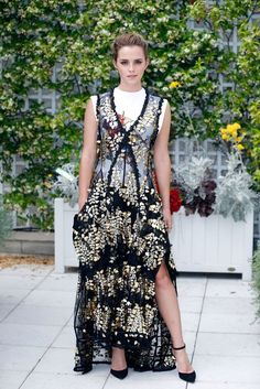 Emma Watson stuns in a Louis Vuitton dress in Paris