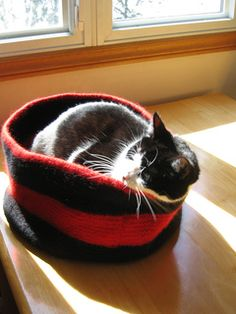 A round, high-sided, felted wool cat bed. Features a welt at the base to keep its shape, and tall sturdy sides - my cat loves her privacy! Uses about three skeins of Cascade 220 wool held double, or you can use bulky yarn.