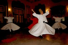 Whirling dervishes at a Whirling Dervishes concert in the Oriental Express railway station, in Istanbul, Turkey.  | by Curious Expeditions.  [Yes, whirling dervishes are actually human beings...]