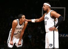 Paul Pierce #34 of the Brooklyn Nets speaks with Shaun Livingston #14 of the Brooklyn Nets during a game at the Barclays Center on March 3, 2014 in the Brooklyn borough of New York City.  (Photo by Nathaniel S. Butler/NBAE via Getty Images)