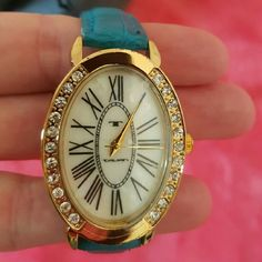 Tavan Watch! Beautiful Tavan watch with crystals -can choose a green or teal genuine leather watchband-worn a few times.Comes with box Tavan Jewelry