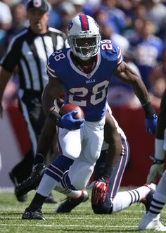 ORCHARD PARK, NY - SEPTEMBER 8: C.J. Spiller #28 of the Buffalo Bills carries the ball during NFL game action against the New England Patriots at Ralph Wilson Stadium on September 8, 2013 in Orchard Park, New York. (Photo by Tom Szczerbowski/Getty Images)