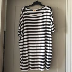 "NWOT PIKO Striped Short Sleeve Tunic NWOT PIKO Striped Short Sleeve Tunic. These do run big! Never worn. Black stripes. Size large. About 29"" long from the middle of the scoop neck in the front. Material is very soft. Piko Tops Tunics"