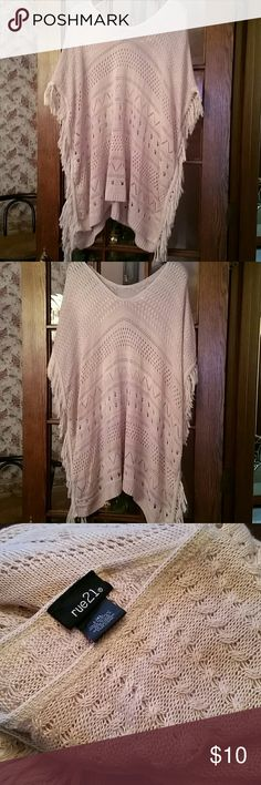 Cozy poncho 100% acrylic open sides v neck and fringe down the sides so soft and cozy the color is mauve or ,kike a dust rose it's in great condition Rue21 Sweaters Shrugs & Ponchos