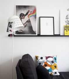 Think creatively about where displays can start: the IKEA PS 2014 lamp has tiny hooks you can hang postcards from.