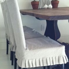 Dining room chair slipcovers from drop cloth. I love the pleats. I could use these!