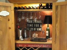 We had an armoire that used to house a TV that we didn't need so I transformed it into a wine bar in our Texas themed den.  We found several fun signs, a wine bottle made into a lamp and a wine glass hanger that we attached to the bottom of the top shelf. I will post additional pictures.