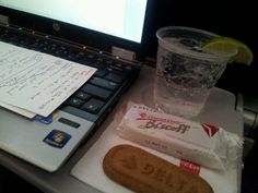 A club soda with lime and a pair of Biscoff cookies have been accompanying nearly all my pursuits of seat-back-tray-table productivity for years.