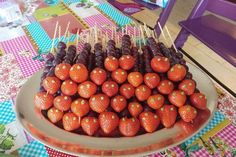 Rupsjes van aardbeien en (rode) druiven