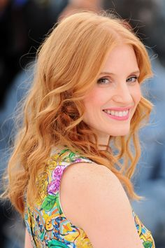 Peachy cheeks and light pink lips, subtle eye makeup and natural waves on Jessica Chastain at Cannes.