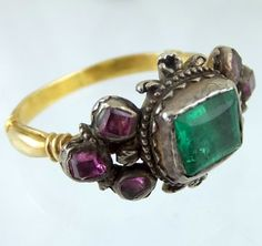 Late seventeenth century gold ring with emerald and rubies. Italian ca 1690.