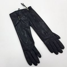 "Long Black Elbow Leather Gloves with Zipper Detail Gorgeous black leather gloves with zipper detail. Lined with soft black fleece, super warm.  Brand new with tags but there is a dent on one hand from storage that will probably not show when worn. 13"" long from tip of middle finger. Please carefully review each photo before purchase as they are the best descriptors of the item. My price is firm. No trades. First come, first served. Thank you! :) Warmen Accessories Gloves & Mittens"