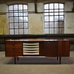 AVAILABLE FOR PURCHASE: Stunning Danish mid century rosewood sideboard by Arne Vodder. Produced by Sibast. The sideboard features rosewood/aluminum handles, bar/cabinet in the end, three drawers, five trays, sliding doors into storage space, and one key. 64 x 165 x 43 cm. Worldwide shipping available. Contact for more information. #webbsmidcentury #vintagefurniture #etsy #ebay #severinhansen  #finnjuhl #hanswegner #arnevodder #midcentury #midcenturymodern #quistgaard #chestofdrawers…