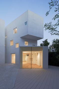 designed by hiroyuki arima + urban fourth, this all-white residence in fukuoka, japan doubles as a exhibition gallery at its ground level.