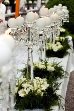 Crystal candelabras with greenery and flowers decoration