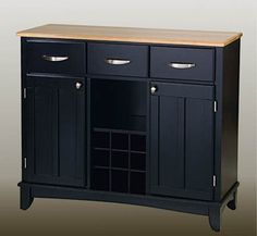 """Home Styles 5100-0041 Large Wood Server Sideboard by Home Styles. $364.40. Color: Black. Wine Rack Built In. Rubberwood Construction. Black Finish. Size: 35.5""""H x 41.75""""W x 16""""D. Finish:Black/Natural   Constructed of hardwood and wood products in a natural finish with a natural wood top.  Features three utility drawers and two wood framed cabinet doors with an adjustable shelf for plenty of inside storage.  Center wine storage area can be removed for open storage if desired.  Bru..."""
