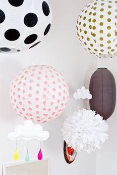 polka dots and paper lanterns decorating this little girl's room  Photography by Julien Fernandez / http://julien-fernandez.com/