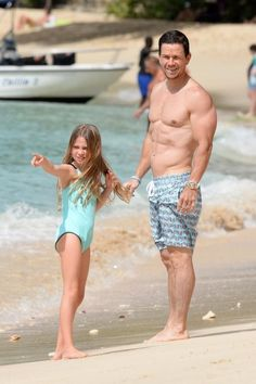 Mark Wahlberg spends a day on the beach with his daughter in Barbados on Jan. 2.