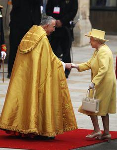 Queen Elizabeth II greets The Right Dr. John Hall, Dean of Westminster.   - HarpersBAZAAR.com