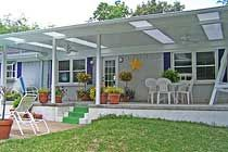 Patio Cover - Palestine, TX: Patio cover with skylights and a ceiling fan.
