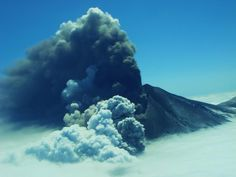 Alaska's Pavlof volcano erupts in 2013, shooting a plume of ash into the air. A steam plume from melting snow and ice can also be seen.