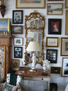 Fabulous gallery wall & look in the mirror, love the bookshelves.