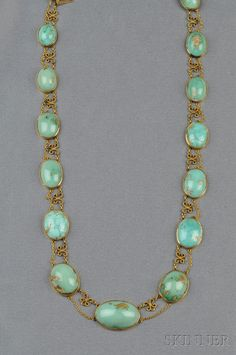Art Nouveau 14kt Gold and Turquoise Necklace, bezel-set with fourteen graduating turquoise cabochons, joined by ribbed scrolls, and completed by swags of trace-link chain, lg. 15 3/4 in.