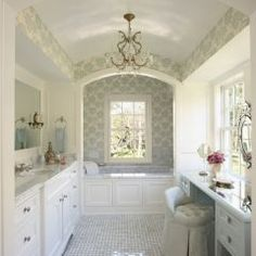 seated area for makeup, tub bath in front of windows, colors, arch in ceiling