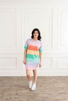 Half sleeved, t-shirt dress. Round neck with multi color striped print. Bright Dress, Color Stripes, Stripe Print, Half Sleeves, Best Sellers, Polyester Spandex, Rainbow, Shirt Dress, Stylish