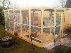 This is a 15 ft x 6 ft x 6 ft run with the Eglu Cube* attached to the outside, with port hole for access.