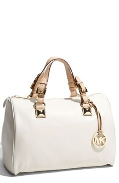Free shipping and returns on MICHAEL Michael Kors 'Grayson' Leather Satchel at Nordstrom.com. Gleaming cutout logo medallion dangles at one side of a supple leather satchel topped with contrast vachetta-leather handles and punctuated by bold pyramid studs.