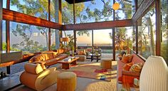 Soaring ceilings, wood and glass walls and amazing views.  Brentwood, CA home designed by Ray Kappe.