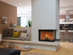 Haus - corner fireplace with sofa next to it and behind the sofa a TV lift so that TV is not in the pictur - Home Living Room, House, Home, Home Fireplace, Living Room With Fireplace, Corner Fireplace, House Interior, Home Deco, Home And Living